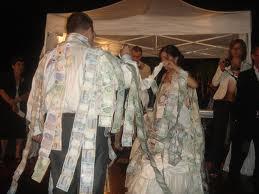 Pinning money on bride
